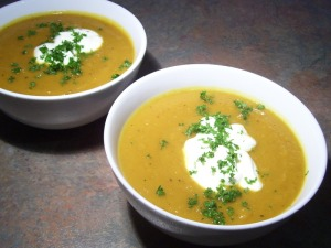 Two bowls of spicy pumpkin soup