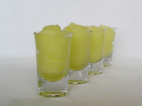 Midori and lemon sorbet - in shotglasses